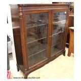 Mahogany 2 Door Bookcase  Auction Estimate $200-$400 – Located Inside