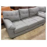 NEW Grey Leather Sofa and Loveseat  Auction Estimate $300-$600 – Located Inside
