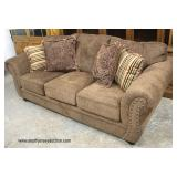 NEW Tan Upholstered Sofa with Decorative Pillows  Auction Estimate $300-$600 – Located Inside