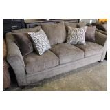 NEW Upholstered Tan Sofa with Decorative Pillows  Auction Estimate $300-$600 – Located Inside