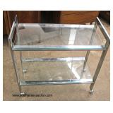 Modern Design Glass and Chrome Tea Cart  Auction Estimate $100-$200 – Located Inside