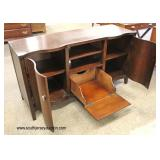 Contemporary Serpentine Front Mahogany Media Cabinet  Auction Estimate $100-$300 – Located Inside