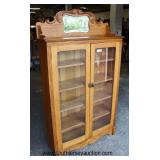 ANTIQUE Oak 2 Door Bookcase with Mirror Back Splash  Auction Estimate $200-$400 – Located Inside
