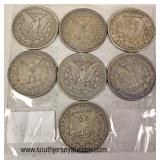 7 Morgan Silver Dollars  Auction Estimate $20-$50 each – Located Glassware