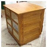 Oak 6 Drawer Panel Side Bean Store Front Display Cabinet  Auction Estimate $200-$400 – Located Insi