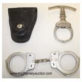 Lot 83: 3pc lot: Smith and Wesson Springfield, Mass. hand cuffs 007013 and Argus Manuf Co. Chicago,