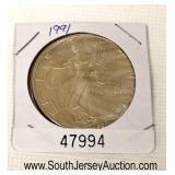 1991 Silver Eagle Dollar  Auction Estimate $20-$50 – Located Glassware