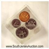 Paperweight with Canadian Coins  Auction Estimate $5-$20 – Located Glassware