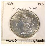 1889 Silver Morgan Dollar  Auction Estimate $20-$50 – Located Glassware