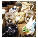 Box Lot of Porcelain Pitchers, Tea Pot, Rabbit, Chocolate Pot, and More  Auction Estimate $50-$100