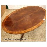 Lot 539: Ethan Allen Furniture burl mahogany and banded oval coffee table