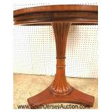 Lot 544 Ethan Allen Furniture burl mahogany and walnut round pedestal center table