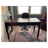 desk and roomsize rug