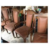 4 vintage dining chairs on wheels.