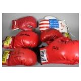 Large collection of signed boxing gloves