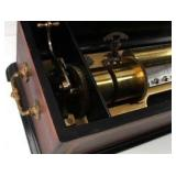 Music box first patented in the US on March 1st, 1881 which appears to play 8 separate songs.