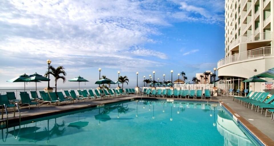 Hilton oceanfront suites logo