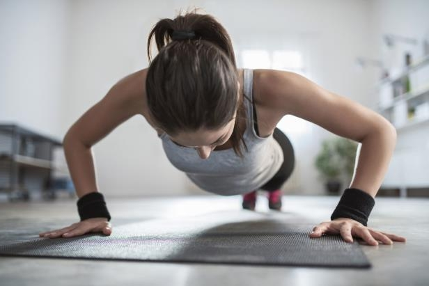 young-athletic-woman-doing-push-ups-one-exercise-that-stands-out-is-the-burpee-which-pushes-your-ent_456093_