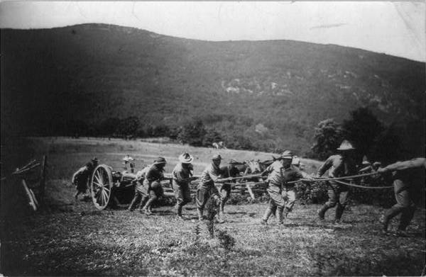 West Point: Cadets pulling large gun up hill