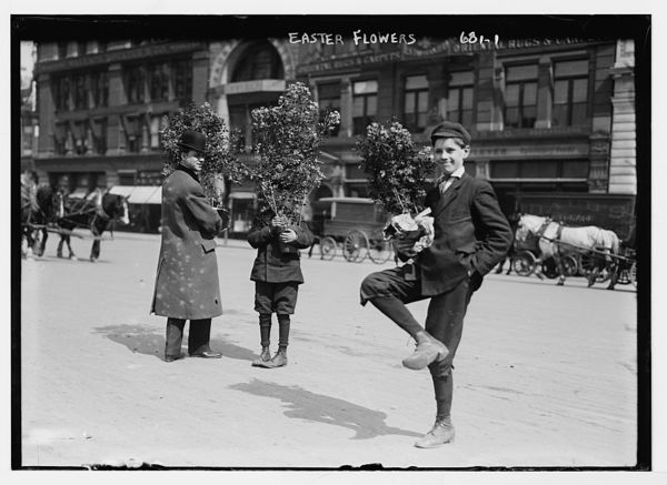 Men holding Easter flowers, New York
