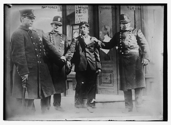Battered striker with policemen, Philadelphia