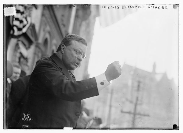 T. Roosevelt speaking, gesticulating with fist, outside, Yonkers, NY