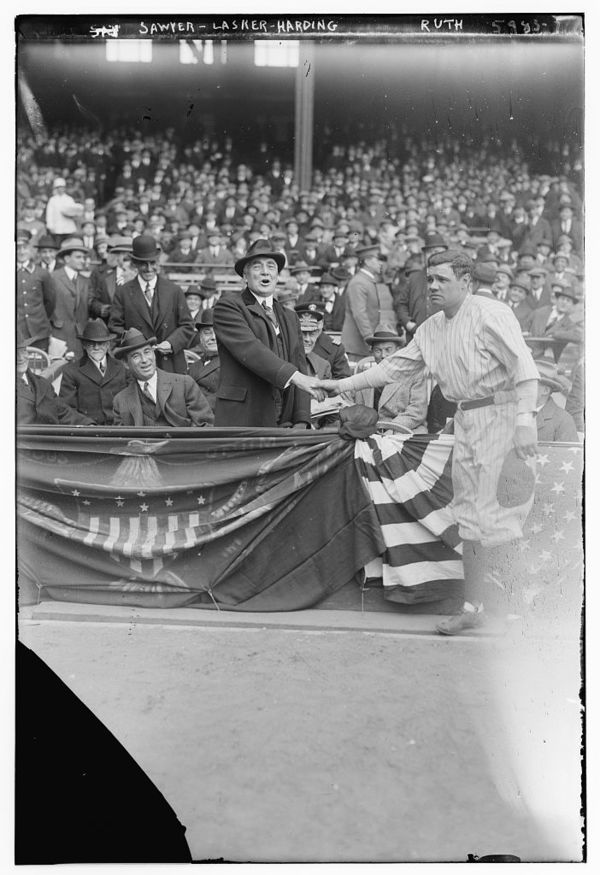 Babe Ruth Shaking Hands With Pres. Warren Harding, at Yankee Stadium 4/24/23; Dr Chas. Sawyer (President's physician) & Albert Lasker also in box (baseball)
