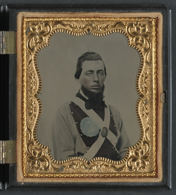 Private Peter S. Arthur of Company B, 11th Virginia Infantry Regiment, in uniform with secession badge and Virginia state seal breastplate
