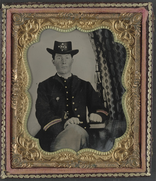 Corporal John I. Guigher of Co. I, 56th Pennsylvania Infantry Regiment in uniform with book