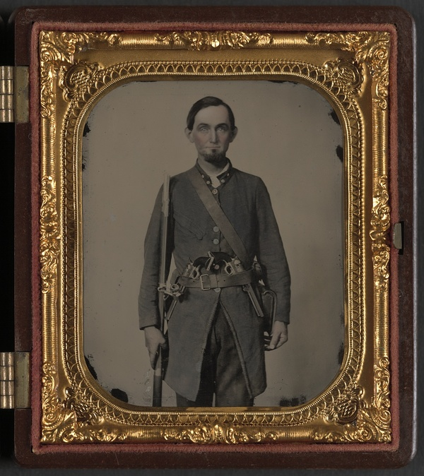 Private Jackson A. Davis of Co. E, Holcombe Legion South Carolina Cavalry Battalion, with musket and two pistols