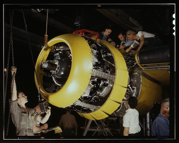 Mounting motor on a Fairfax B-25 bomber, at North American Aviation, Inc., plant in Inglewood, Calif.