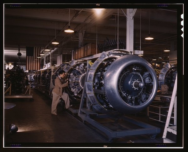 Cowling and control rods are added to motors for North American B-25 bombers as they move down the assembly line, North American, Inc., Inglewood, Calif.