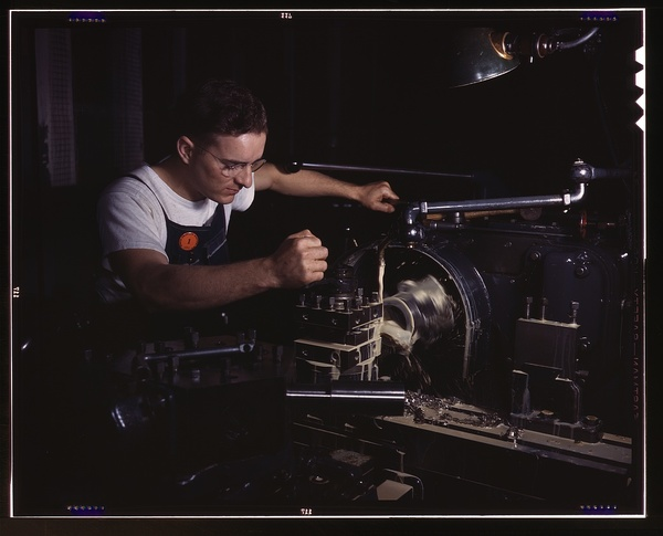 In North American's modern machine shop, another aircraft part is finished on a huge turret lathe, North American Aviation, Inc., Inglewood, Calif.