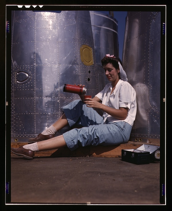 Girl worker at lunch also absorbing California sunshine, Douglas Aircraft Company, Long Beach, Calif.