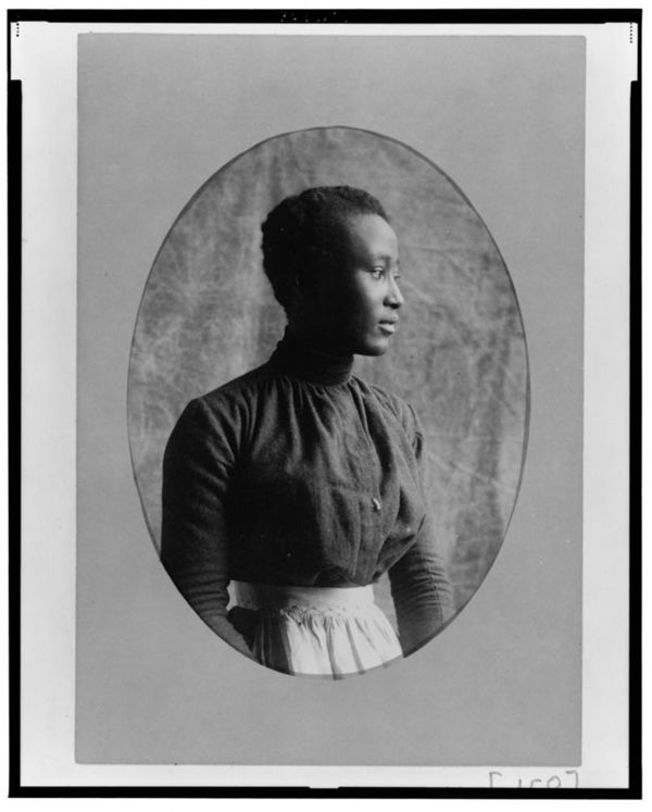 African American woman, half-length portrait, facing right