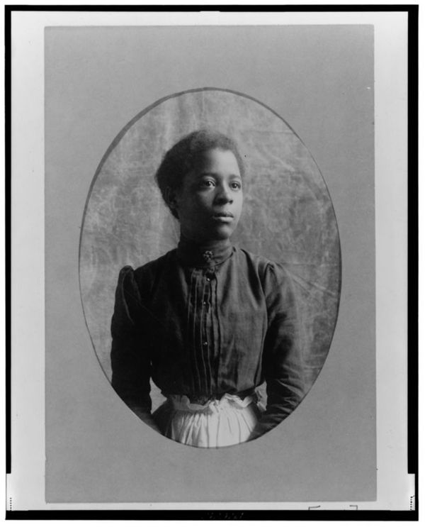 African American woman, half-length portrait, facing slightly right