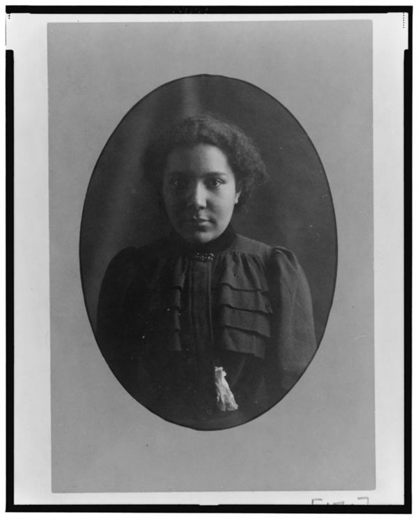 African American woman, half-length portrait, facing front