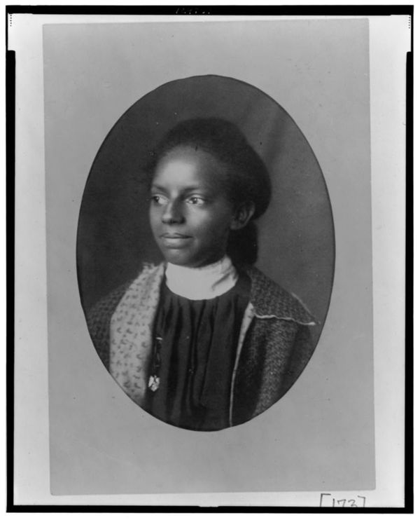 African American woman, head-and-shoulders portrait, facing left