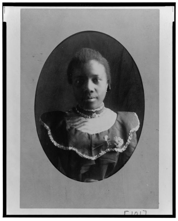 African American woman, head-and-shoulders portrait, facing front