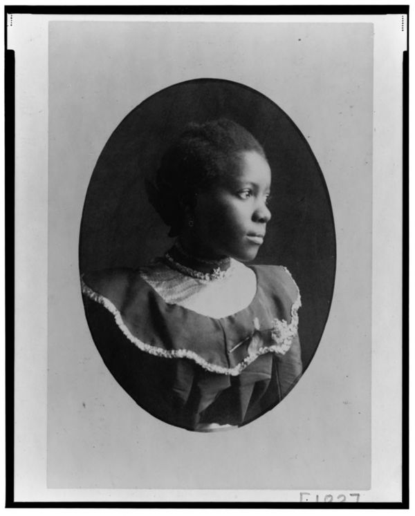African American woman, head-and-shoulders portrait, facing right