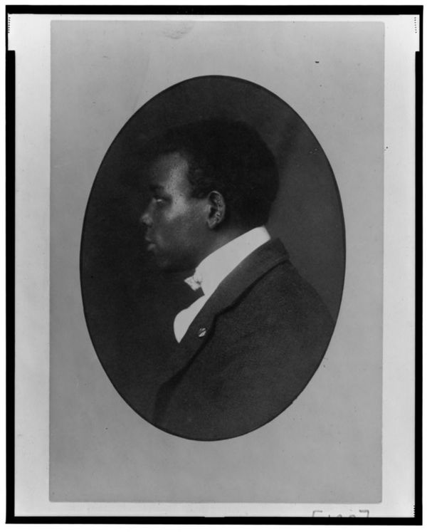 African American man, head-and-shoulders portrait, left profile