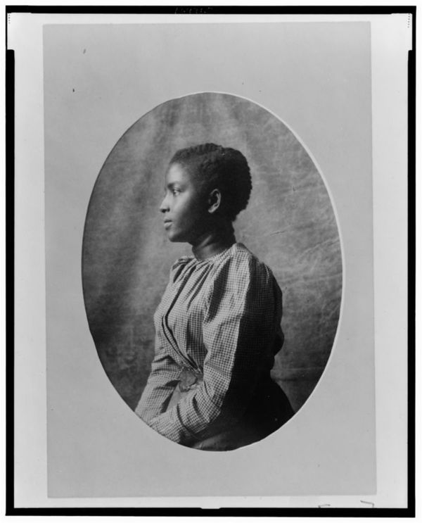 African American woman, half-length portrait, left profile