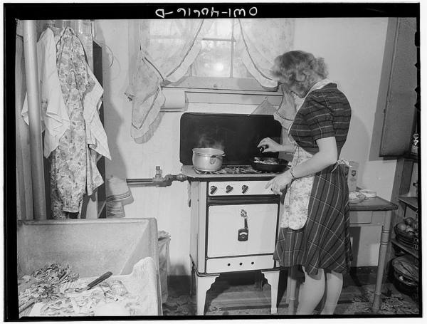 Washington, D.C. Lynn Massman, wife of a second class petty officer who is studying in Washington, cooking dinner