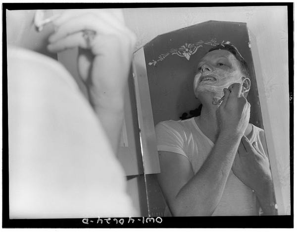 Washington, D.C. Hugh Massman, a second class petty officer who is studying in Washington, shaving