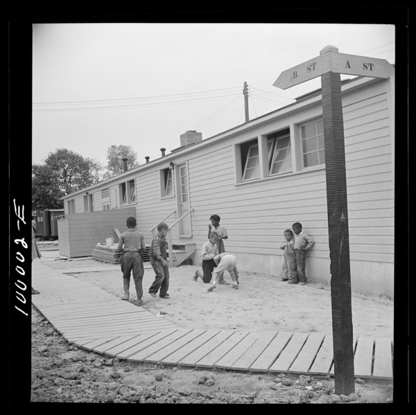 Arlington, Virginia. FSA (Farm Security Administration) trailer camp project Children playing marbles outside the community building