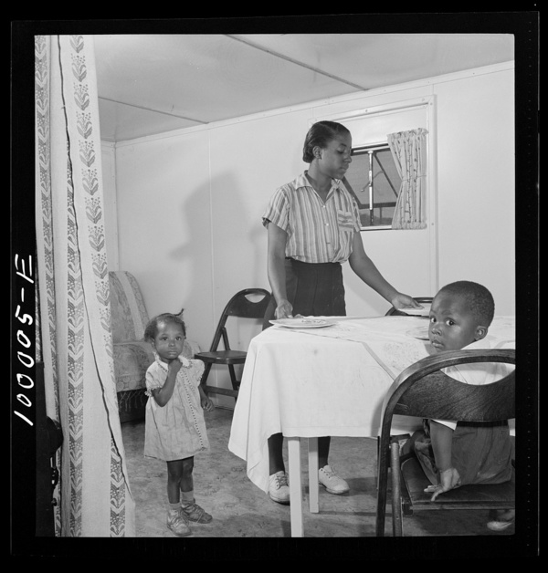 Arlington, Virginia. FSA (Farm Security Administration) trailer camp project Interior of an expansible trailer, showing one wing used as a dining and living room