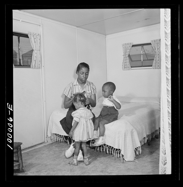 Arlington, Virginia. FSA (Farm Security Administration) trailer camp project Interior of an expansible trailer, showing one wing used as a bedroom
