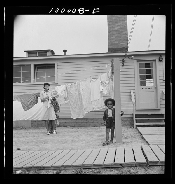 Arlington, Virginia. FSA (Farm Security Administration) trailer camp project Hanging out clothes which have been washed in the laundry of the community building