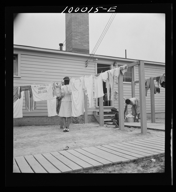 Arlington, Virginia. FSA (Farm Security Administration) trailer camp project Hanging out washing in front of the community building