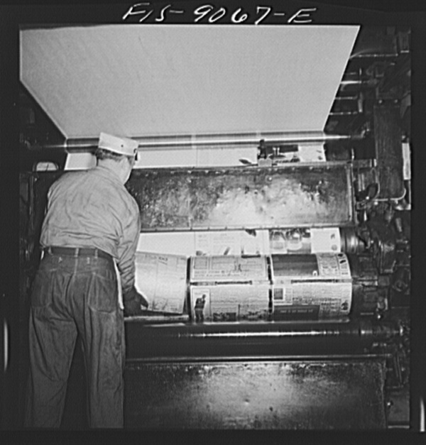 New York, New York. Pressroom of the New York Times newspaper. Placing plates on cylinder of press